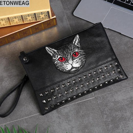 embroidery designs cartoons NZ - Original design cat style embroidery fashion hand grab bag large capacity rivets shoulder bag street fashion embroidery leather hand holding