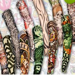 disegni manica braccio tatuaggio Sconti L'arte provvisoria falsa del manicotto del tatuaggio 3D del corpo di arte del manicotto del tatuaggio di arte calda mista 12pcs progetta il tatuaggio freddo delle calze Trasporto libero
