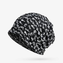b12cb7a4f4b PXNDX autumn cap 2018 new cotton Lady fashion skullies beanies scarf dual  use women hat floral pattern Windproof