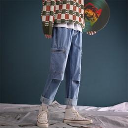 2018 Nuevo estilo retro de los hombres de trabajo Baggy Homme Cargo Pocket Jeans Classic Negro / azul pantalones casuales Biker Denim pantalones tamaño M-2XL desde fabricantes