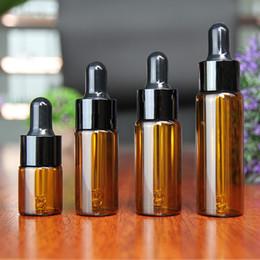 bouteille d'huile essentielle vis brune ambrée Promotion 50pcs / lot 20 ml bouteilles d'huile essentielle verre réactif liquide pipette bouteille oculaire compte-gouttes goutte aromathérapie vente