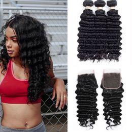 Ondas de pelo comprar online-El pelo peruano suelta Extensiones de cabello humano de onda profunda Remy Hair puede comprar 3 lotes de color natural con cierre