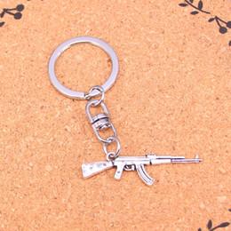 Llaves de ametralladora online-Nuevo Diseño ametralladora rifle de asalto ak-47 llavero coche llavero llavero colgante de plata para el hombre regalo de las mujeres