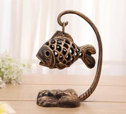 tè di ghisa Sconti Lanterna da giardino in stile vintage Lanterna a forma di pesce Lampada giapponese da tavolo Tealight Tea Light Holder Decorazioni per la casa Portacandele in metallo Retro Bronze