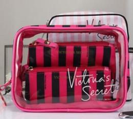 Wholesale pvc makeup case - Designer Brand Logo PVC Women's Cosmetic Bags Potable 3-pieces Set Lipstick Storage Cases Waterproof Zipper Pencil Bag Mini Makeup Bags