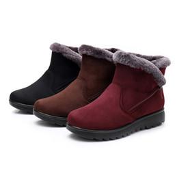 Botas de invierno caramelos online-Para mujer de diseño de lujo para mujer de alta calidad de invierno tobillo Martin botas cortas de nieve calzado de piel cálidos zapatos de color caramelo