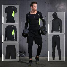 Marca Running Set 2018 Mens Sports Suits Fitness Training Ropa deportiva  Medias de compresión Baloncesto Jogging Trajes Ropa de gimnasia 37e8049713699