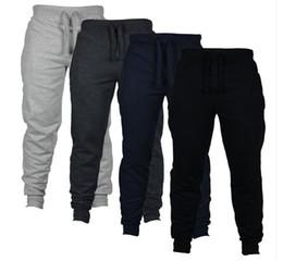 Pantaloni lunghi sudore pantaloni online-Pantaloni sportivi jogger casual Pantaloni sportivi jogging pantaloni di colore solido Pantaloni traspiranti elastico in vita Moda uomo pantaloni lunghi Abbigliamento