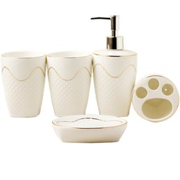 Wholesale ceramics sanitary ware - European-style relief Sanitary Ware five sets of wash sets bathroom supplies suite mouthbaths ceramic bathroom supplies