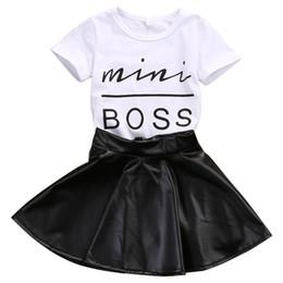 2018 Nueva moda para niños pequeños Ropa para niña Conjunto de verano de manga corta Mini Boss T-shirt Tops + Falda de cuero 2 UNIDS Outfit Traje de niño desde fabricantes