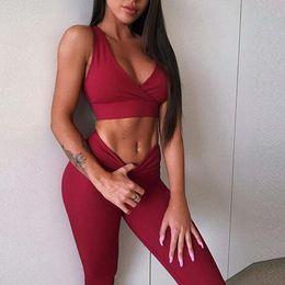 2019 pantaloni poplini 2018 Nuove Donne Sexy Tuta Yoga Set Nero Crop Top Push Up Leggings Sport Vita Alta In Esecuzione Pantaloni 2 pz Palestra Abbigliamento Sportwear