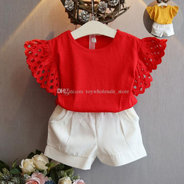 Wholesale Flying Outfits - Children Flying sleeves outfits girls Hollow sleeves top+shorts 2pcs set 2018 summer Baby suit Boutique kids Clothing Sets 2 colors C3838
