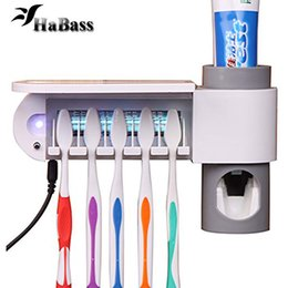 Wholesale Wall Mounted Holder - 3-in-1 Toothpaste dispenser toothbrush holder and Toothbrush Sanitizer Sterilizer Set Wall Mount Stand Family Tools