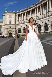 Wholesale Flower Gardens Designs - New Design Sexy V Neck Pure White A Line Wedding Dresses 2018 Crystal Beading Sash Sleeveless Backless Bridal Gowns Sweep Train ba8977