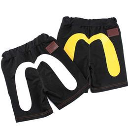 Pantalones cortos de mezclilla de lujo de diseño Pantalones cortos de niño con moda de bolsillo Japón Logotipo de marca famosa Ropa de bebé niño desde fabricantes
