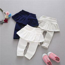 le neonate legging i pantaloni della gonna di cotone per la ragazza cute il colore della caramella i pantaloni dei bambini i vestiti di marca dei bambini leggings del bambino 0-3Y da