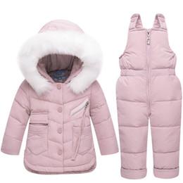 Argentina 2018 ropa de invierno para niños conjunto bebé niña mono chaqueta abajo para niños ropa de abrigo espesar esquí nieve traje cheap jumpsuit babies Suministro