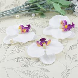 Le teste di orchide all'ingrosso online-Nozze 100pcs all'ingrosso Farfalla di seta Orchidea testa di fiore artificiale per la decorazione domestica di nozze Orchs Flores Cymbidium Piante di fiori