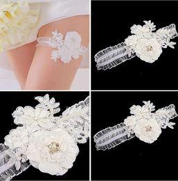 Ligas nupciales de encaje blanco 2015 Accessoreis boda modesto hecho a mano perlas de flores Lentejuelas cristalinas Ligas de boda Moda sexy desde fabricantes