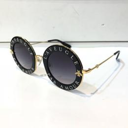 68240be65b Gafas de sol de lujo 0113S para la moda de las mujeres 0113 Diseñador de la  ronda de verano estilo negro Marco de oro lente de protección UV de alta  calidad ...