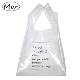 Wholesale wholesale clear pvc handbags - Moon Wood Transparent Handbag Printing Letters Clear Tote Bag Wrist Clutch Summer Beach Bag PVC Hand Girls Shopping 2018
