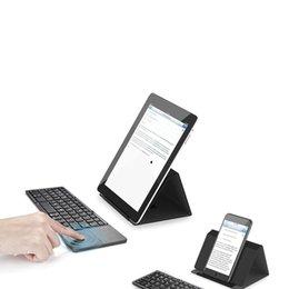 Складывающаяся клавиатура для android онлайн-Ультра тонкий свет ABS мини Bluetooth 3.0 складной клавиатуры тачпад с тремя слоями с батареей для Windows Android