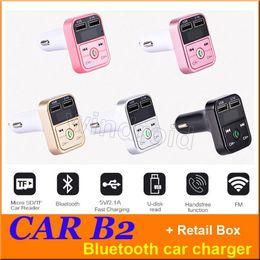 Bluetooth mp3 mas barato online-El más barato CAR B2 Multifunción Bluetooth Transmisor 2.1A Dual USB Cargador de coche FM Reproductor de MP3 Equipo de auto Soporte Tarjeta TF Manos libres + caja de venta al por menor