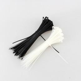 Legami di filo bianco online-100pcs x di 100mm x 3mm avvolgono il trasporto libero dei colori bianchi neri autobloccanti del cavo dei legami del cavo dell'involucro della chiusura lampo