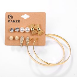 Wholesale United Angels - Europe and the United States fashion alloy ring earrings 6 pairs of pearl bow angel wings women's earrings set