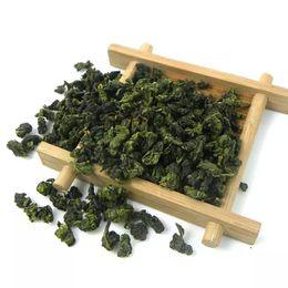 Wholesale oolong tea flavor - China anxi tieguanyin oolong tea tie guan yin luzhou-flavor tieguanyin tea premium with blue and white porcelain gift 10pcs  box