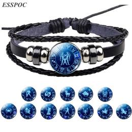 bracelet zodiacal leo Promotion Signe du zodiaque Bouton Bracelet Cancer Lion Vierge Balance Scorpion Gemini 12 Bracelet En Cuir Tresse Punk