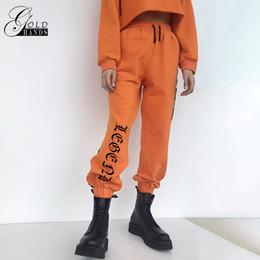 Canada Pantalons de survêtement en vrac Harajuku Pantalons Automne Femme Orange Lettre Imprimé Joggers Pantalon Pantalon De Danse Hip Hop Plus La Taille cheap women hip hop dance sweatpants Offre