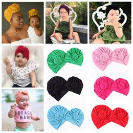 Gorros atados bebê on-line-2 pçs / set família chapéu de harmonização sólida bow knot hat mom bebê esporte yoga turbante chapéus outono inverno Gorros Gorros Foto Adereços FFA997 12 lote
