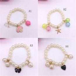 7b922296702f niña pulseras brazaletes Rebajas Baby Girl pulsera bowknot forma de  acrílico pulsera brazalete de joyería para