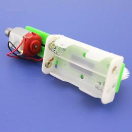 2019 kits de trenes de juguete Cepillo de coche RC Model Kit DIY Scientific Toys Producción pequeña Coche de juguete de vibración para Science Training Experimento rebajas kits de trenes de juguete