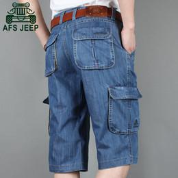 2018 bordado praia Verão Nova Marca Mens Denim Jeans Shorts de Algodão  Bolso Grande Solto Baggy 970d704d755
