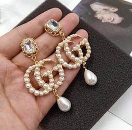 Moda temperamento de alta calidad de diamantes de imitación colgante de la perla de la mujer pendientes de la tendencia simple joyería del oído desde fabricantes