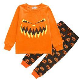 db41bd321b23 Boy girl Halloween Pumpkin Pyjamas set 2018 Nuovi bambini Cotone a maniche  lunghe T-shirt + pantaloni 2 pezzi Abiti B camicie pigiama economici