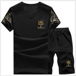 camiseta de manga corta capucha Rebajas 2018 Nuevo Mens Hood Traje de manga corta Hombres Jogger Set Short T Shirt Hombres Pantalones Chándal y Chaqueta Mens Chándal