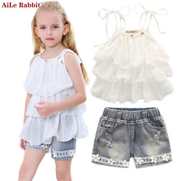 255d635e80d Summer Korean children s clothing girls Chiffon cake sling pants 2pcs pearl  flower halter top denim kids Set
