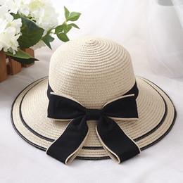 HT1169 Moda Caliente Cinta Negra Arco Sombreros de Paja Sólido Mujer Verano  Sombreros de Ala Ancha Playa Sol Señoras Estilo de Corea Bucket rebajas  sombrero ... ed5af1bde37