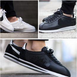 cheaper 78386 287e2 Nouveau Classic Marques de cuir Cortez Casual Shoes hommes et femmes  chaussures de cortez loisirs Shells mode extérieur Sneakers Étanche  Athletic chaussures ...