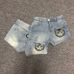 Wholesale denim spots - The spot in the summer of 2018 with a home embroidery cat washed denim shorts shorts flash sequins catwork