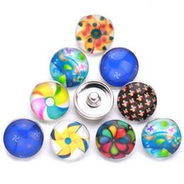 Argentina Nuevo botón a presión de vidrio de molino de viento multicolor al azar 10 piezas / lote 18mm para mujeres accesorios de joyería clásica al por mayor C67-1 cheap multi color glass jewelry Suministro