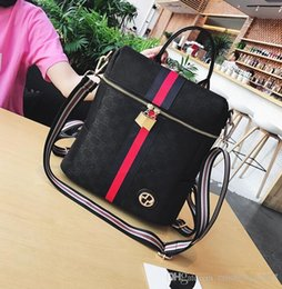 Wholesale multifunctional style women backpack - Factory wholesale brand handbag fashion fringe Leather Backpack backpack color classic woman portable multifunctional lock leather schoolbag