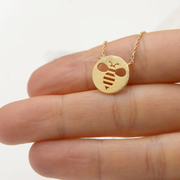 Wholesale gold bee necklace - Fashion bees pendant necklaces Lovely circle hollow out the bees pendant necklaces The bee shadow charm necklaces for women