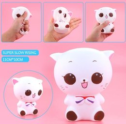 Wholesale cell phone pendants - ePacket Squishy Smile Cat White 12cm Slow Rising Toys Relieve Stress Cake Sweet Animal PU Cell Phone Strap Phone Pendant Key Chain Gift