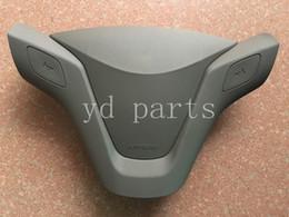 Cubre volante chevrolet online-Volante SRS Airbag cubierta para Chevrolet Sail Air cubierta cubierta Conductor Nueva bolsa de aire cubierta envío gratis