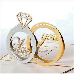 Lasergeschnittene einladungen china online-heißer Verkauf Gold Laser schnitt 3d Ring Pop-up Hochzeits-Einladungen Romantischer handgemachter Valentinstag für Liebhaber-Postkarten-Gruß-Karte 2 ringAJI-771