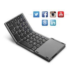 2019 ventanas plegable tableta Protable A18 Bluetooth teclado plegable dos veces plegable teclado táctil inalámbrico BT para IOS / Android / Windows tableta ipad rebajas ventanas plegable tableta